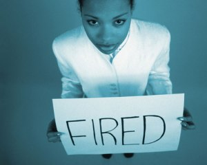 Businesswoma-holding-fired-sign-board